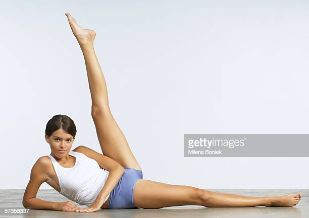 Young woman doing leg lifts