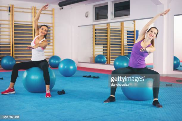 Young woman doing pilates exercises