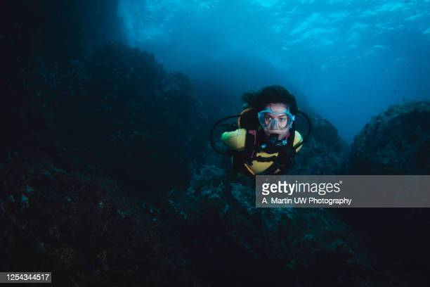 young woman doing scuba-diving in the mediterranean sea - underwater diving stock pictures, royalty-free photos & images