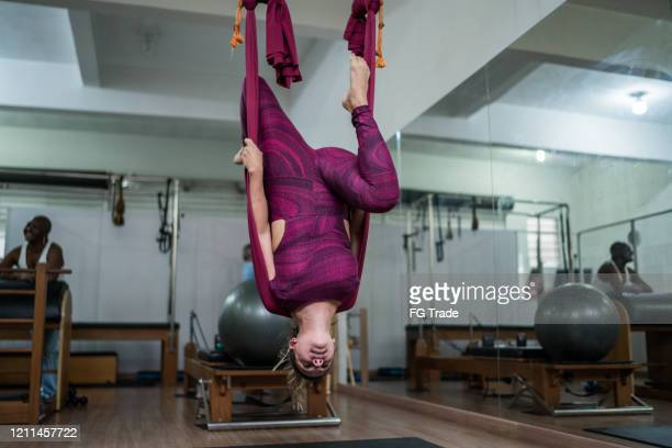 young woman doing some beautiful positions - sports medicine stock pictures, royalty-free photos & images