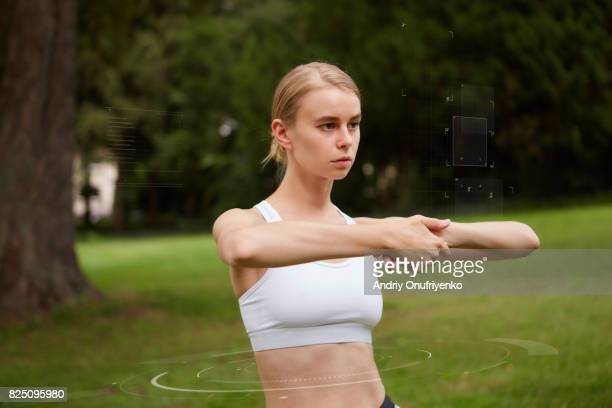 Young woman doing sport exercises outside