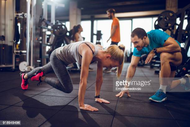 young woman doing stretching exercise - fitness instructor stock pictures, royalty-free photos & images