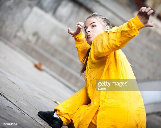 young woman doing tai chi - kung fu yoga stock pictures, royalty-free photos & images