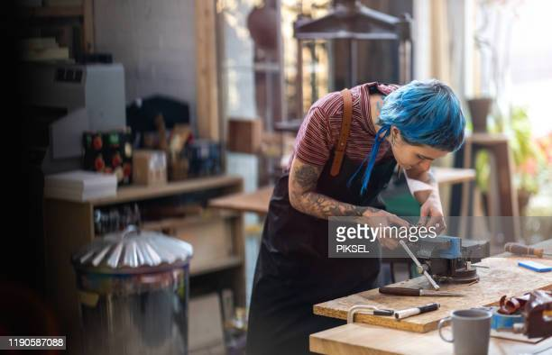 young woman doing woodwork workshop