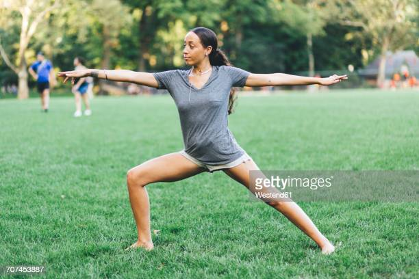 Young woman doing yoga exercise in a park