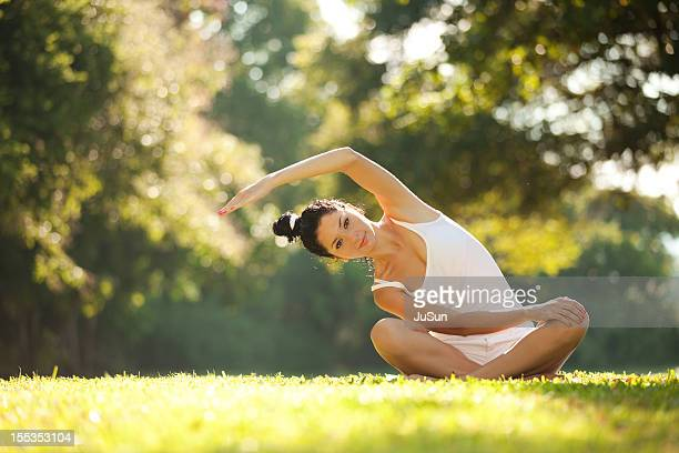 Young woman doing yoga exercise in the nature