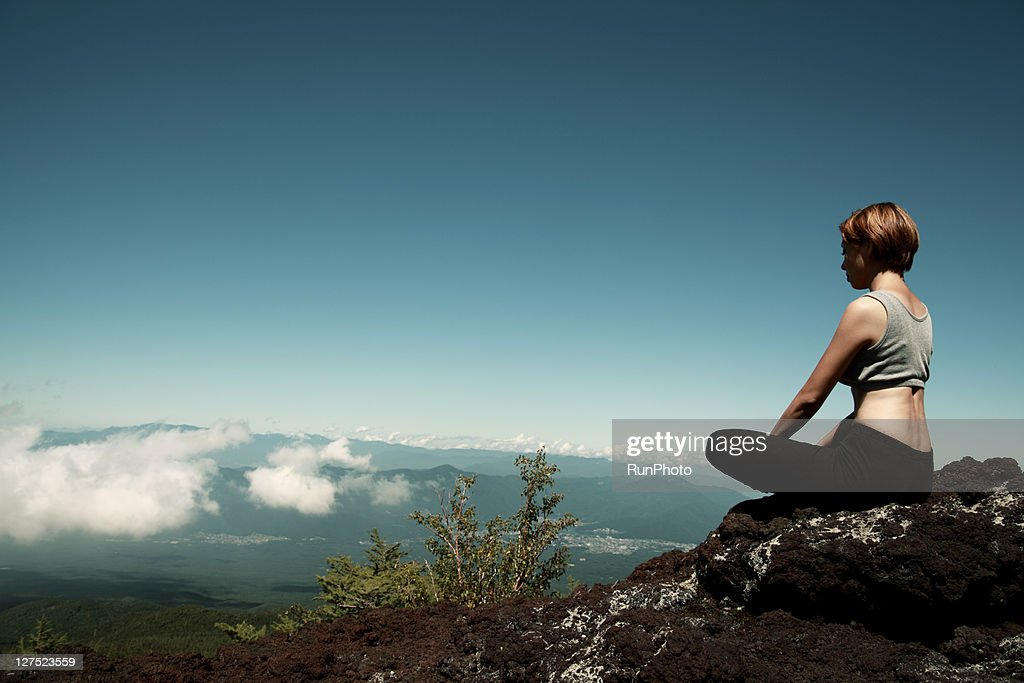 young woman doing yoga in the mountains : Stock Photo