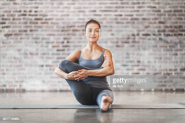 Young Woman Doing Yoga Meditation and Stretching Exercises