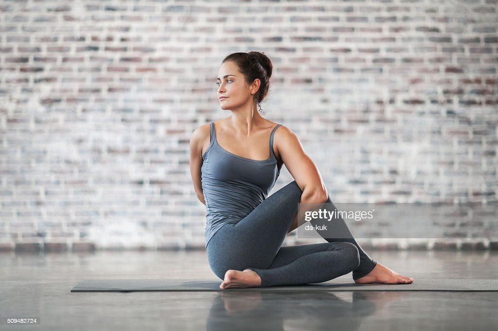 Young Woman Doing Yoga Meditation and Stretching Exercises : Stock Photo