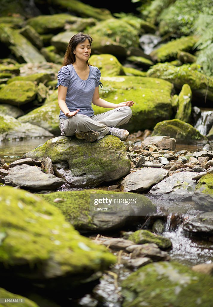 Meditation in forest stock photo. Image of meditating