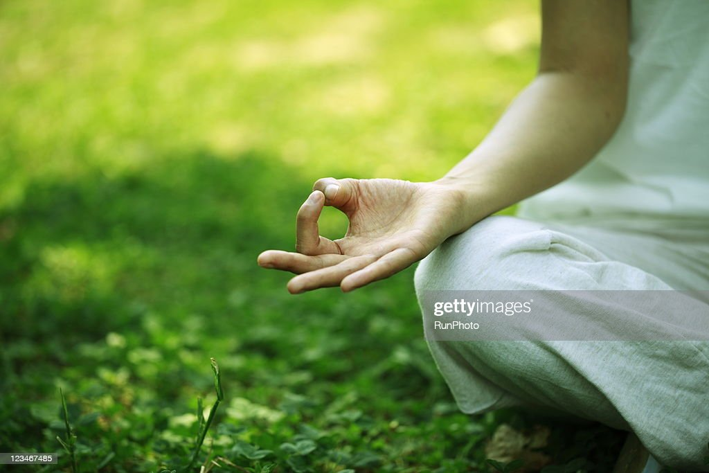 young woman doing yoga,hand close-up : Stock Photo