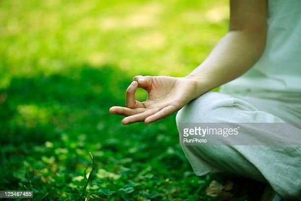 young woman doing yoga,hand close-up - vivere semplicemente foto e immagini stock