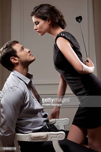 young woman dominating - women dominating men stock photos and pictures