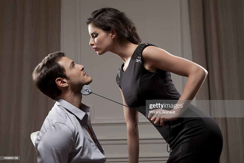 Young woman dominating : Stock Photo