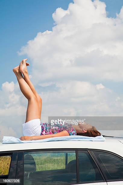 Female Rooftop Sunbathing Stock Photos And Pictures