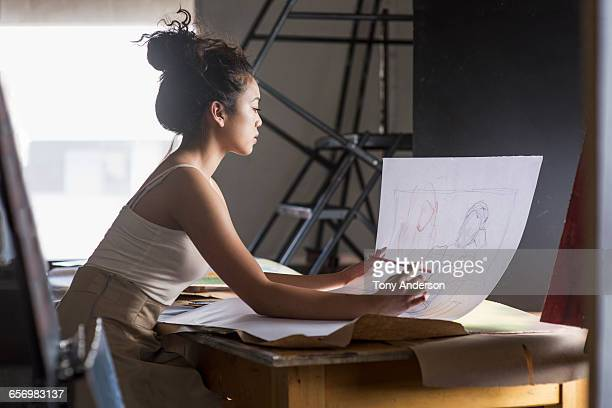 Young woman drawing in art studio
