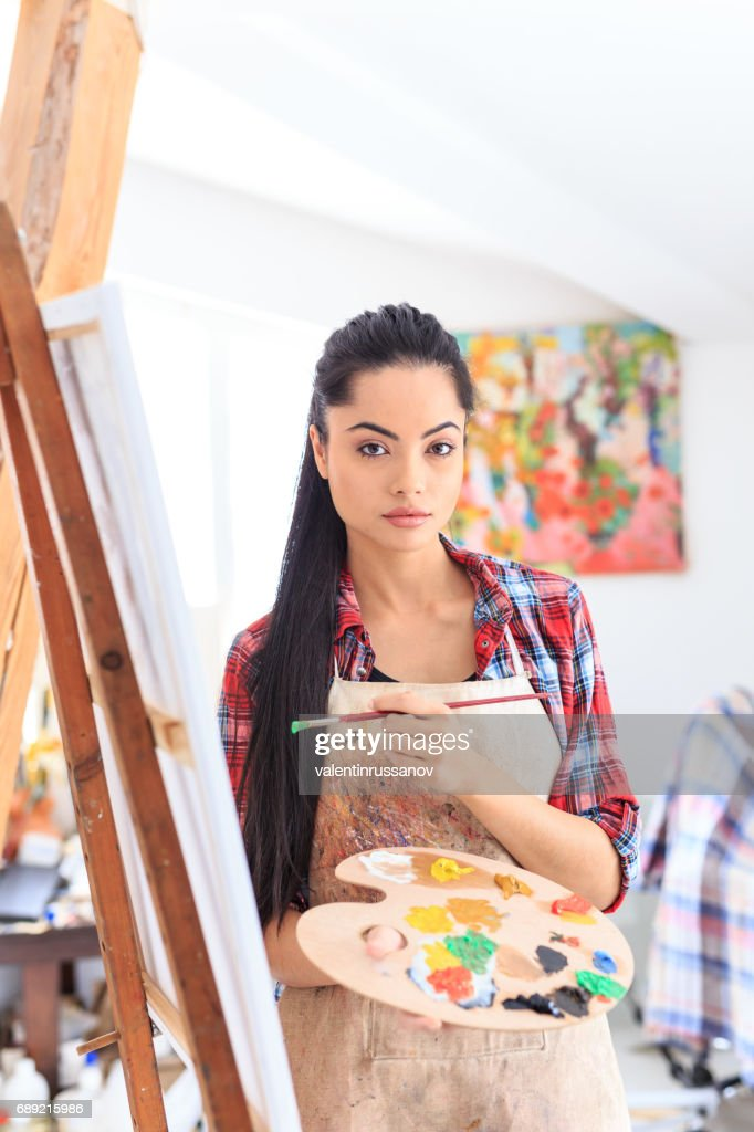 Young woman drawing in art studio : Stock Photo