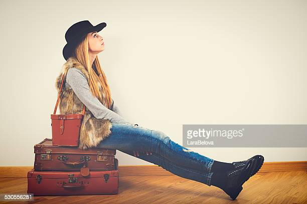 Young woman dreaming about travels