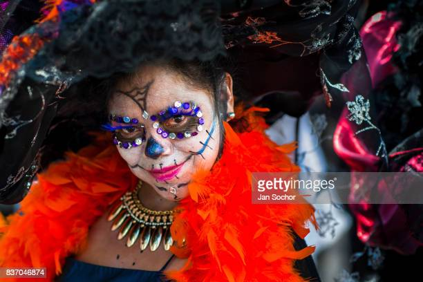 A young woman dressed as La Catrina a Mexican pop culture icon that represents Death performs during the Day of the Dead festivities October 29 2016...