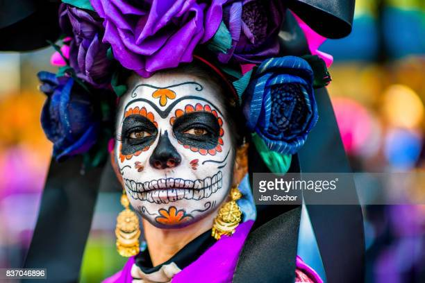 A young woman dressed as La Catrina a Mexican pop culture icon that represents Death performs during the Day of the Dead festival on October 29 2016...