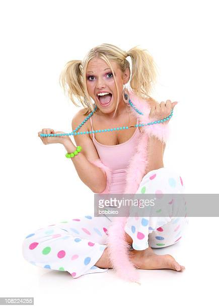 Young Woman Dressed in Colorful Pajamas on White Background
