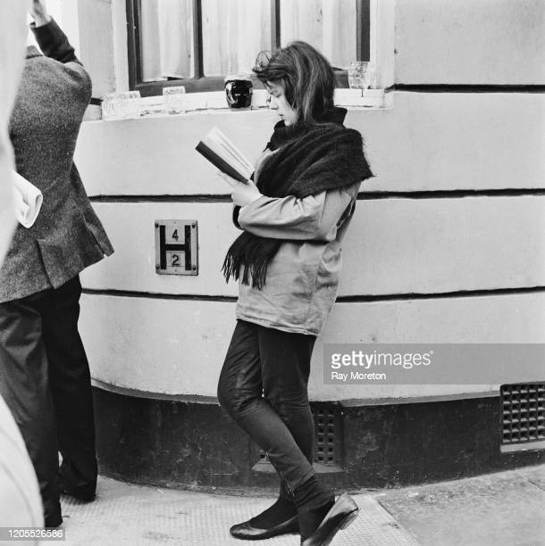 A young woman dressed in the fashionable style associated with the Chelsea bohemian set London September 1959 The contemporary caption describes the...