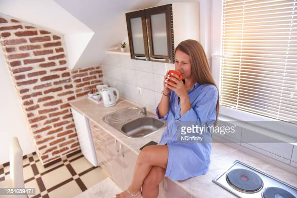 young woman drink coffee from cup at home stock photo - coffee drink stock pictures, royalty-free photos & images