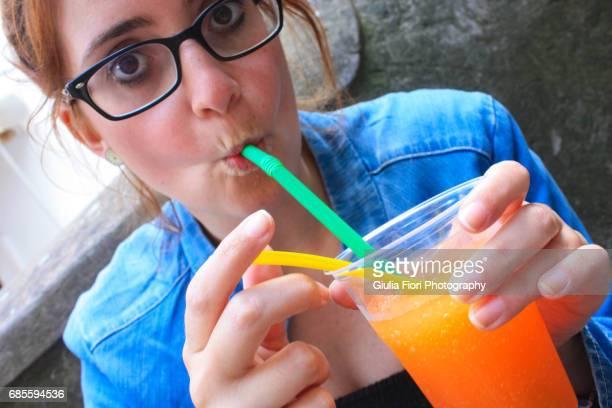 Young woman drinking a granita
