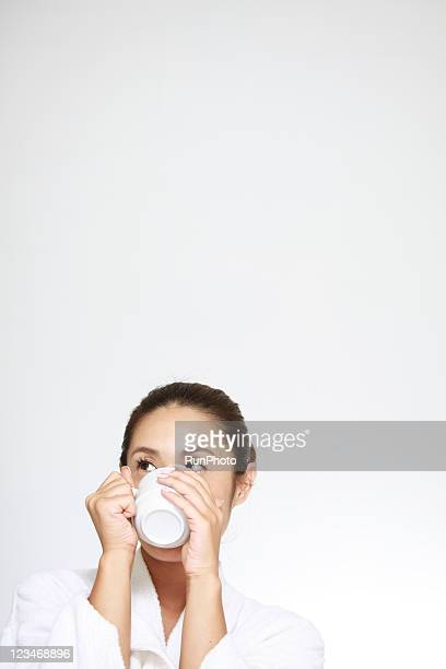 young woman drinking beverage - newhealth stock photos and pictures