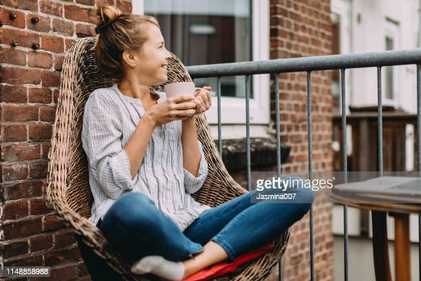 young woman drinking coffee at home - apartment stock pictures, royalty-free photos & images