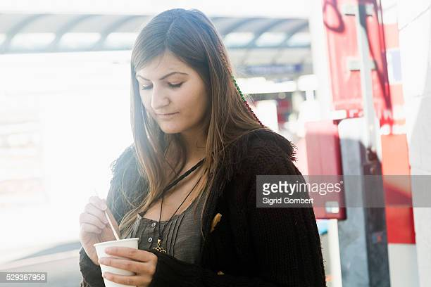 young woman drinking coffee in city, freiburg im breisgau, baden-w��rttemberg, germany - sigrid gombert fotografías e imágenes de stock