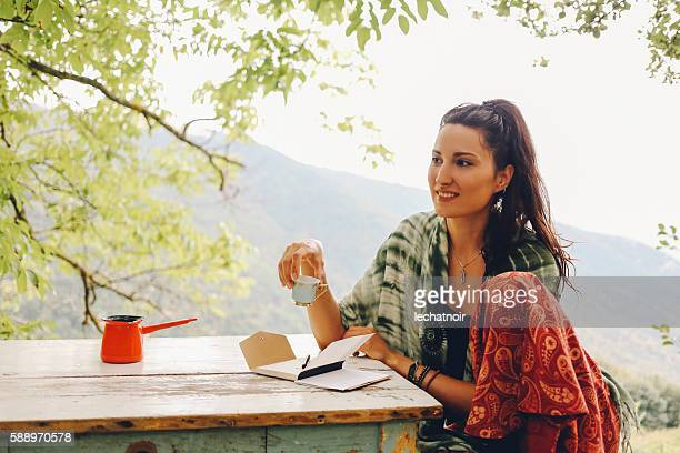 Young woman drinking coffee in the beautiful nature
