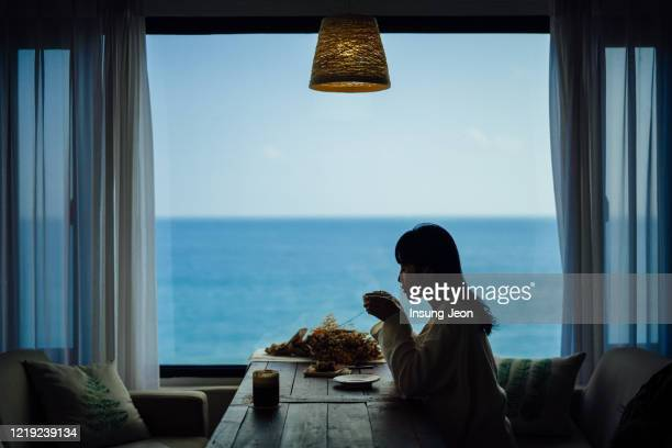 young woman drinking coffee - south korea stock pictures, royalty-free photos & images