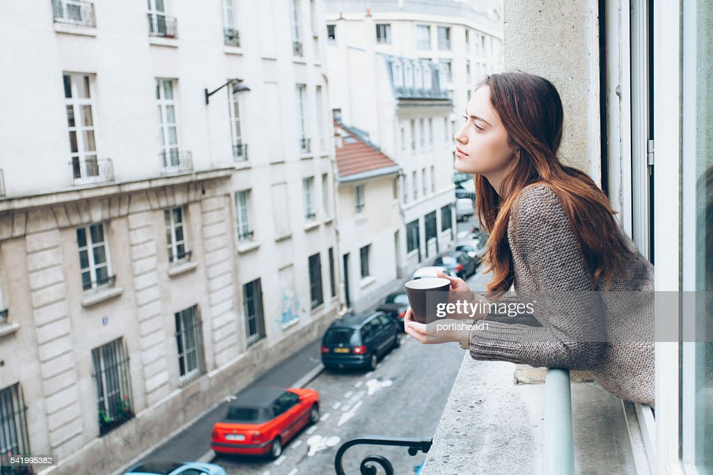 Young woman drinking coffee : Stock Photo