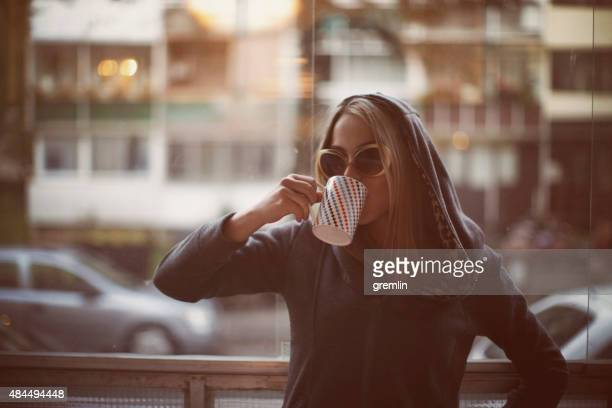 young woman drinking late morning coffee - hangover stock pictures, royalty-free photos & images