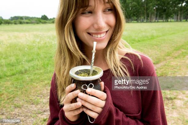 young woman drinking mate in gourd - argentina women stock pictures, royalty-free photos & images