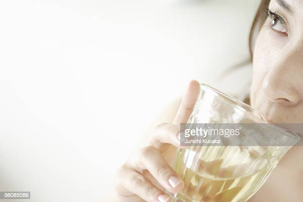 A young woman drinking