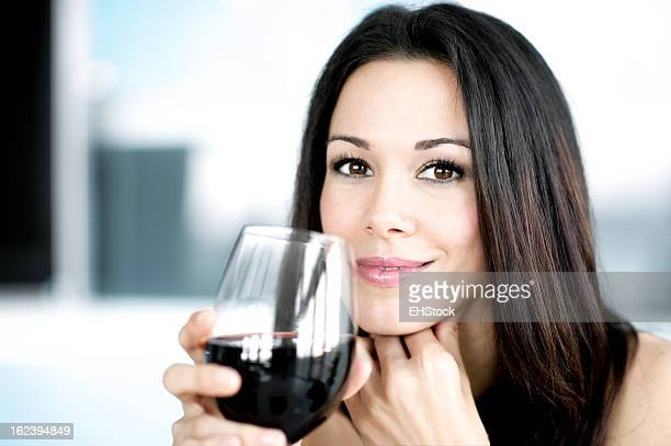 Young Woman drinking red wine