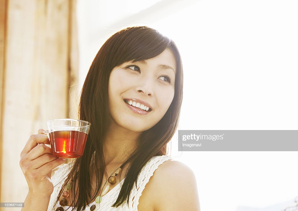Young woman drinking tea : Stock Photo