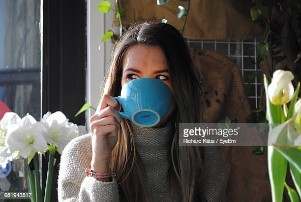 young woman drinking tea - smirking stock pictures, royalty-free photos & images