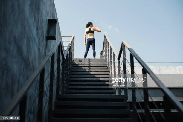 young woman drinking water in exersize - center athlete stock pictures, royalty-free photos & images