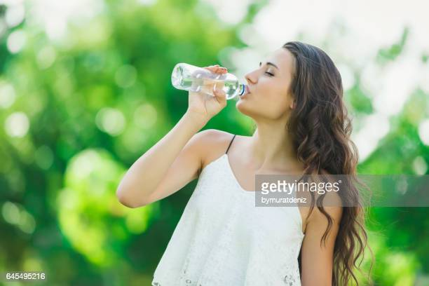 young woman drinking water - hot teen stock pictures, royalty-free photos & images