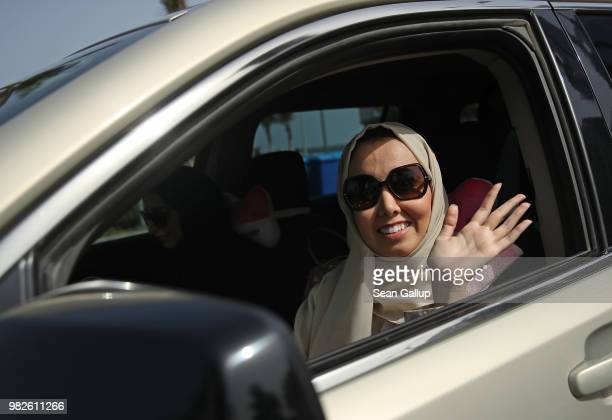 A young woman drives a car on the first day she is legally allowed to drive in Saudi Arabia on June 24 2018 in Jeddah Saudi Arabia Saudi Arabia has...
