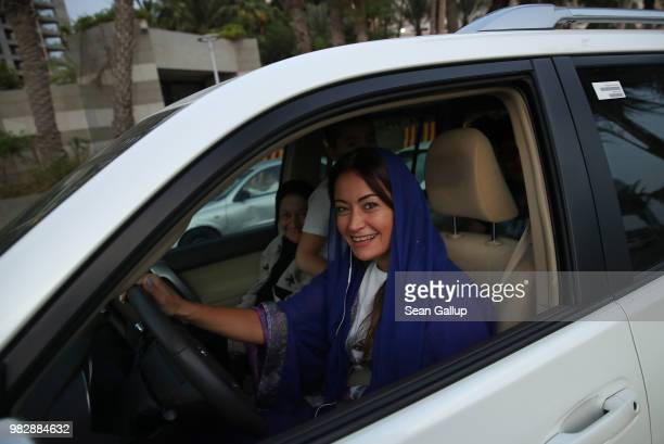 A young woman drives a car on the first day that she is legally allowed to drive in Saudi Arabia on June 24 2018 in Jeddah Saudi Arabia Saudi Arabia...