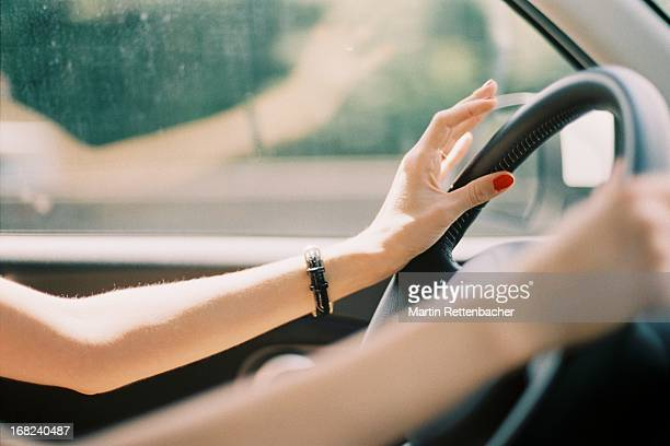 young woman driving car - red nail polish stock pictures, royalty-free photos & images