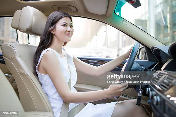 young woman driving car - 中国北東部 ストックフォトと画像