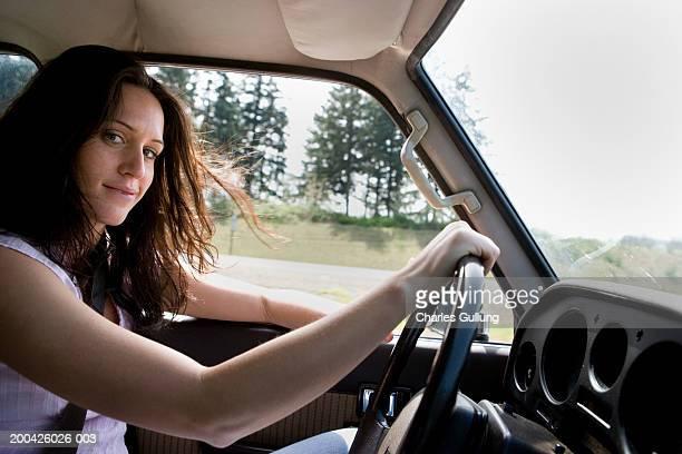Young woman driving car, portrait