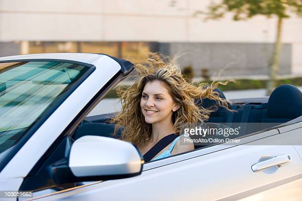Young woman driving convertible