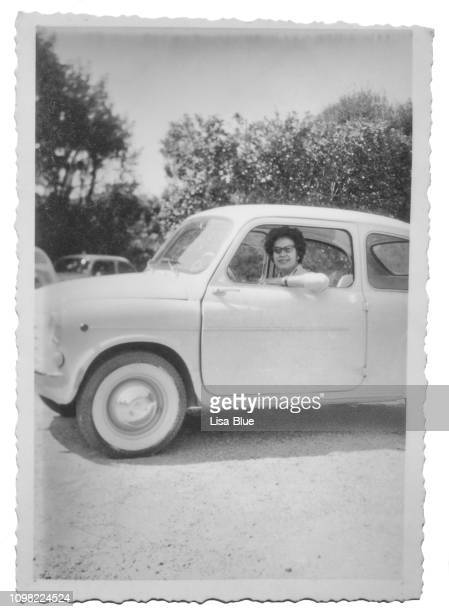 young woman driving fiat 600 car in 1960 - 1960 stock pictures, royalty-free photos & images