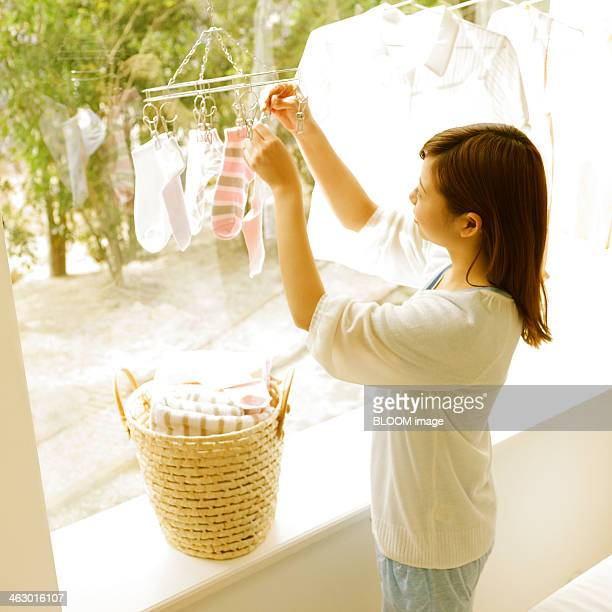 Young Woman Drying Clothes